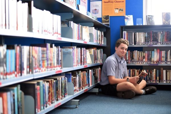 St Patrick's College Sutherland - student reading book in library