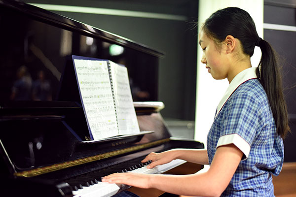 St Patrick's College Sutherland - student playing the piano