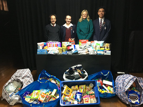 St Patrick's College Sutherland - students and teachers with hampers of food donations