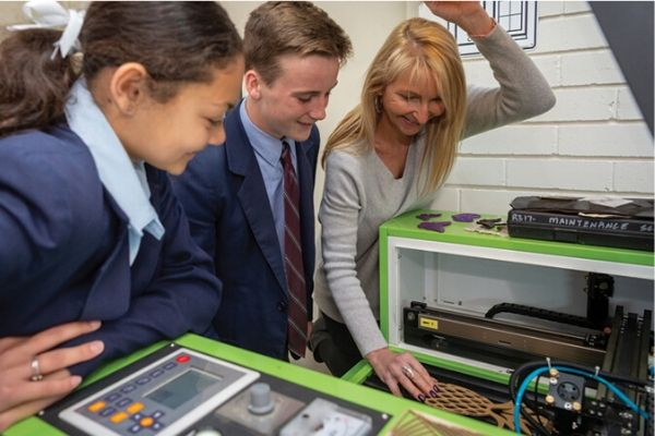 St Patricks College Sutherland - 2 students interacting with teacher and 3D printer