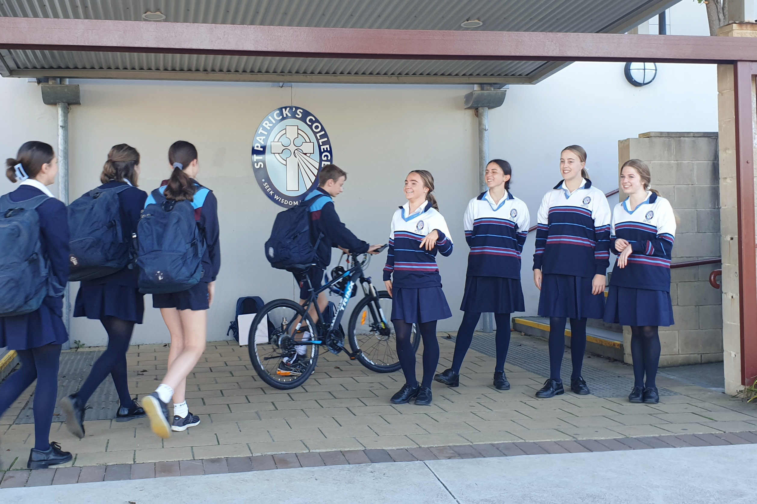 St Patrick's College students are greeted at the school gate by their student leaders on Feel Good Friday